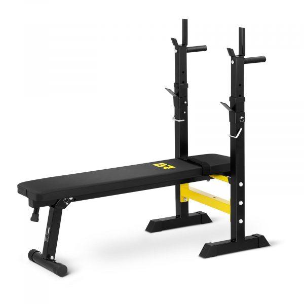 Posilňovacia lavica pod veľkú činku s držiakmi na dipy s nosnosťou 100 kg pre uloženie činiek. Vhodná na cviky bench-press, dipy aj skracovačky.